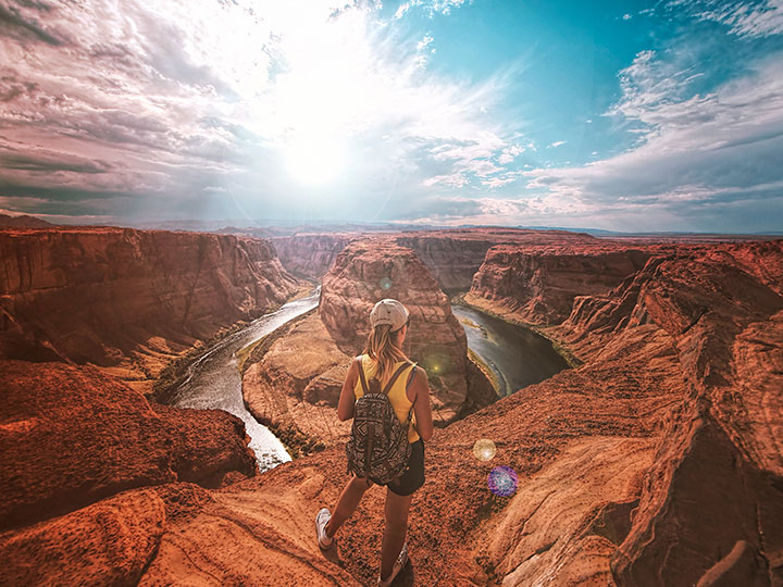 A tour participant overlooks the Grand Canyon's Horseshoe Bend
