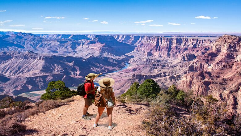 Two visitors take a bus tour from Vegas to the Grand Canyon.