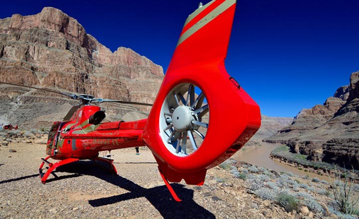 Rear view of a helicopter landed by the Colorado River in the Grand Canyon
