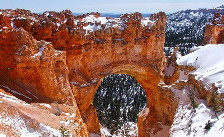 Natural Bride Rock in Bryce Canyon National Park during winter covered in snow.