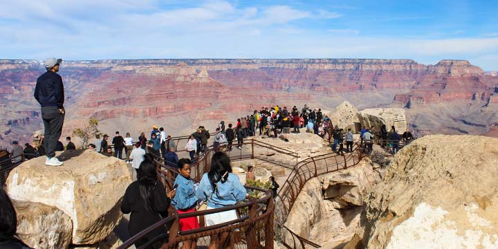 A group of visitors admiring the Grand Canyon's South Rim