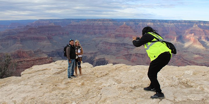 Grand Canyon tours have dedicated tour guides to take photos.